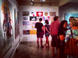 Gallery-goers peruse artwork at Speedy Grandma art gallery in Bangkok