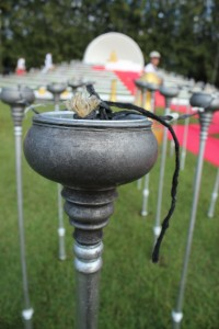 A close-up of the torch used to light the lanterns at Loi Krathong
