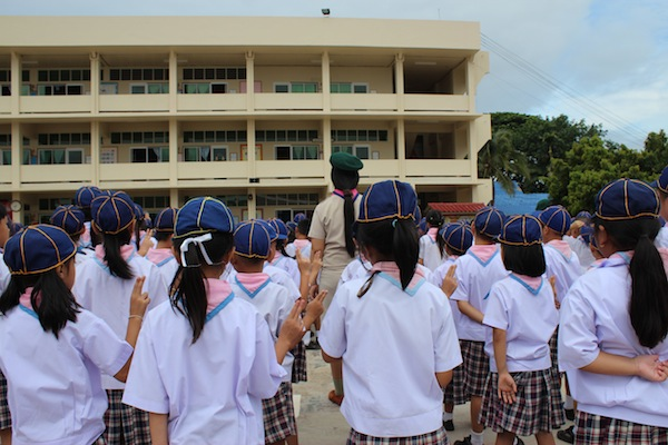 students saluting in the morning in Thailand